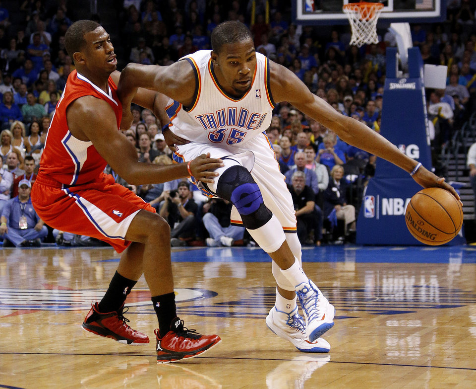 Oklahoma City's Kevin Durant (35) tries to get past the Clippers Chris Paul (3) during an NBA basketball game between the Oklahoma City Thunder and the Los Angeles Clippers at Chesapeake Energy Arena in Oklahoma City, Wednesday, Nov. 21, 2012. Photo by Bryan Terry, The Oklahoman