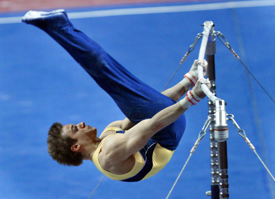 Photo - Michigan's Sam Mikulak competes in the high bar at the event finals of the men's NCAA Men's Gymnastics Championships at the Lloyd Noble Center on Saturday, April 21, 2012, in Norman, Okla.  Photo by Steve Sisney, The Oklahoman