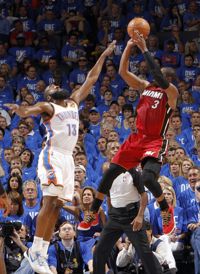 Miami's Dwyane Wade (3) shoots over Oklahoma City 's James Harden (13) during Game 1 of the NBA Finals between the Oklahoma City Thunder and the Miami Heat at Chesapeake Energy Arena in Oklahoma City, Tuesday, June 12, 2012. Photo by Chris Landsberger, The Oklahoman
