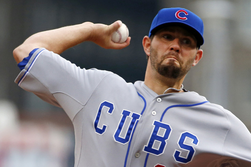 Photo - Chicago Cubs starting pitcher Jason Hammel delivers during the first inning of a baseball game against the Pittsburgh Pirates in Pittsburgh, Thursday, April 3, 2014. (AP Photo/Gene J. Puskar)