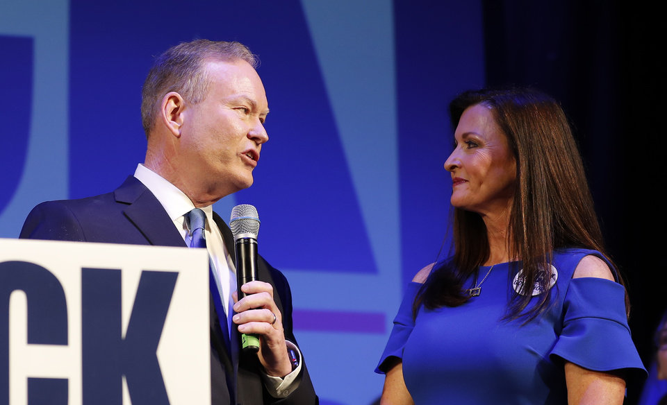 Photo - Mick Cornett looks at his wife Terri Cornett while speaking to supporters and volunteers during his watch party inside the Tower Theater in Oklahoma City, Okla. on Tuesday, June 26, 2018. (Photo by Alonzo Adams for The Oklahoman)