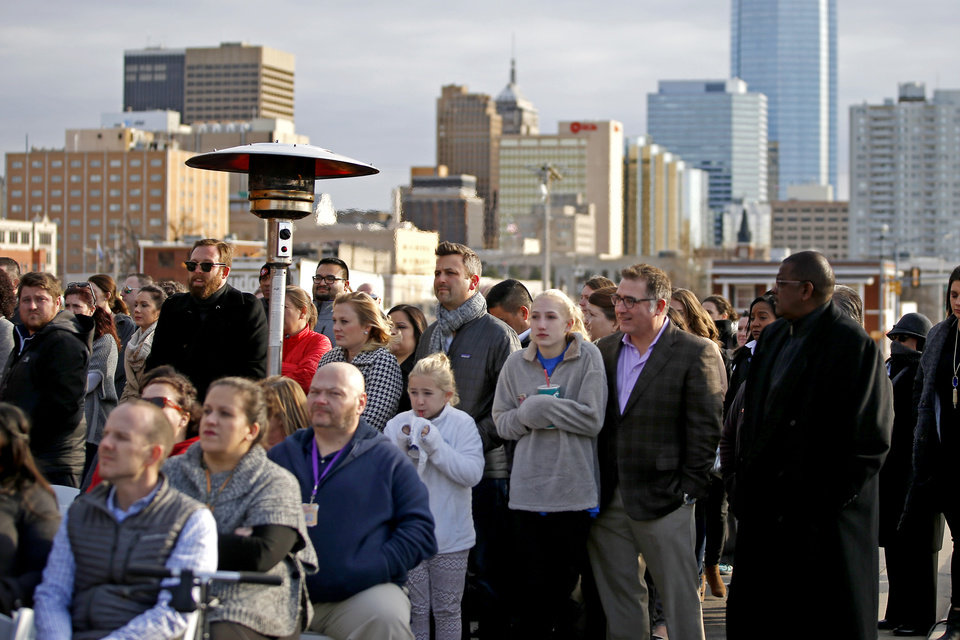 Photo -  People stand in the cold during the grand opening. [Photo by Bryan Terry, The Oklahoman]