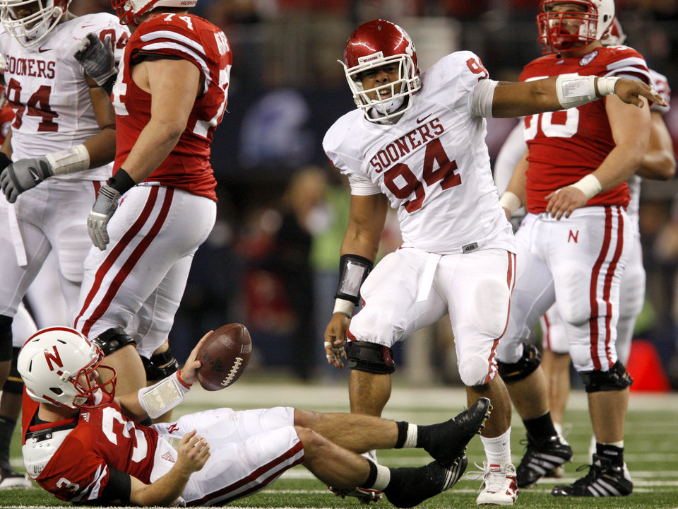 Photo - OU's Pryce Macon celebrates after bringing down Nebraska's Taylor Martinez during the Big 12 football championship game between the University of Oklahoma Sooners (OU) and the University of Nebraska Cornhuskers (NU) at Cowboys Stadium on Saturday, Dec. 4, 2010, in Arlington, Texas.  Photo by Bryan Terry, The Oklahoman
