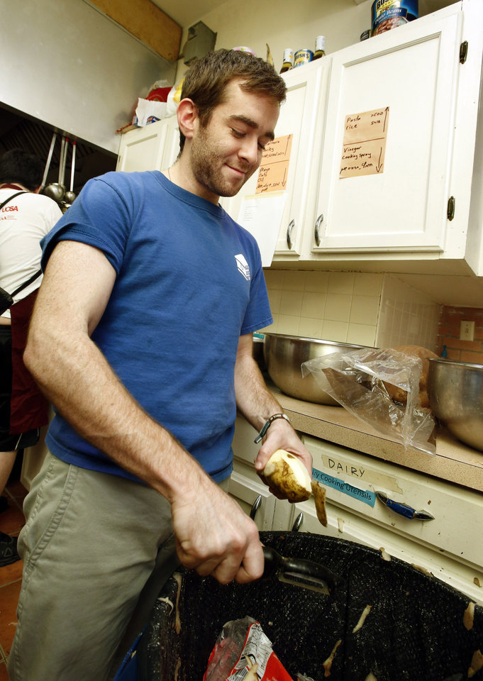 University of Oklahoma student David Goldsmith peels potatos to make latkas, the traditional potato pancakes served during Hanukkah, at the Hillel foundation's Latkas for Love annual fundraiser on Thursday, Nov. 29, 2012, in Norman, Okla.  