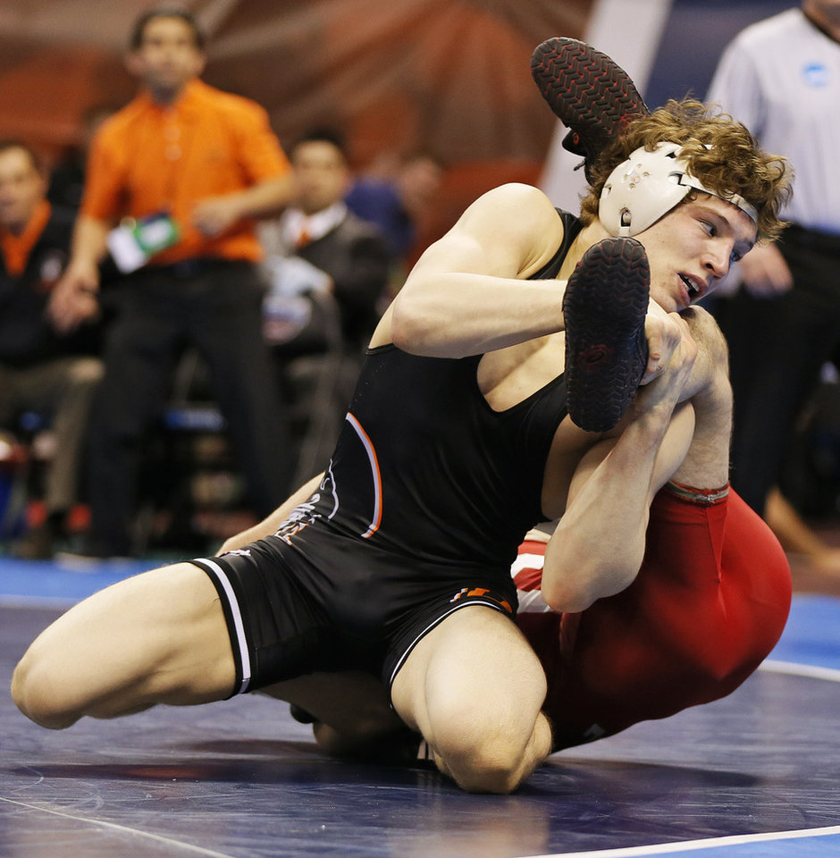 Photo - OSU's Alex Dieringer, left, wrestles Cornell's Brian Realbuto in a 157-pound semifinal during the 2014 NCAA Div. I Wrestling Championships at Chesapeake Energy Arena in Oklahoma City, Friday, March 21, 2014. Photo by Nate Billings, The Oklahoman