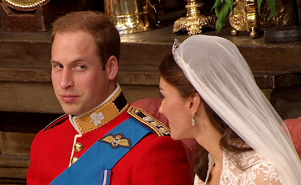 Photo - In this image taken from video, Britain's Prince William, left, looks at his wife, Kate, the Dutchess of Cambridge, at Westminster Abbey for the Royal Wedding in London on Friday, April, 29, 2011. (AP Photo/APTN) EDITORIAL USE ONLY NO ARCHIVE PHOTO TO BE USED SOLELY TO ILLUSTRATE NEWS REPORTING OR COMMENTARY ON THE FACTS OR EVENTS DEPICTED IN THIS IMAGE ORG XMIT: RWVM189