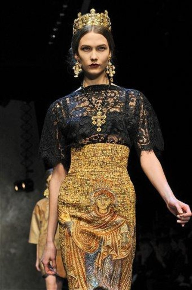 A model wears a creation for Dolce & Gabbana women's Fall-Winter 2013-14 collection, part of the Milan Fashion Week, unveiled in Milan, Italy, Sunday, Feb. 24, 2013. (AP Photo/Giuseppe Aresu)