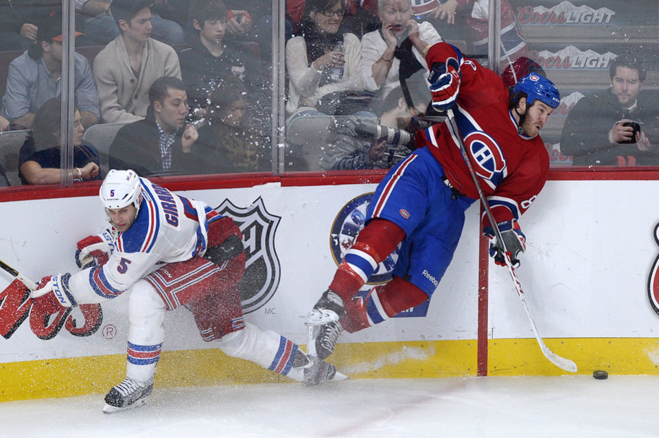 Montreal Canadiens\' Brandon Prust, right, collides with New York Rangers\' Dan Girardi during the third period of an NHL hockey game in Montreal, Saturday, Feb. 23, 2013. The Canadiens won 3-0.(AP Photo/The Canadian Press, Graham Hughes)