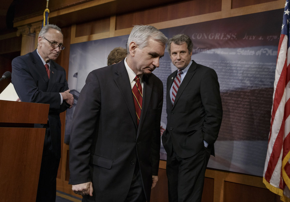Photo - Sen. Jack Reed, D-R.I., center, joined by Sen. Charles Schumer, D-N.Y., left, and Sen. Sherrod Brown, D-Ohio, right, leaves a news conference on Capitol Hill in Washington, Tuesday, Jan. 7, 2014, after legislation to renew jobless benefits for the long-term unemployed unexpectedly cleared an initial Senate hurdle. The vote was 60-37 to limit debate on the legislation, with a half-dozen Republicans siding with the Democrats on the test vote. Sen. Reed, along with Republican Sen. Dean Heller of Nevada, led the effort to reauthorize the benefits for three months which expired on Dec. 28. (AP Photo/J. Scott Applewhite)