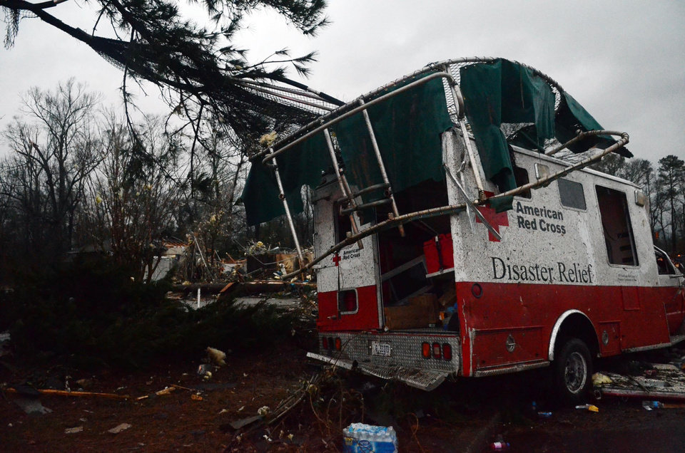 A trampoline rests on top of a damaged American Red Cross disaster relief truck outside of the Hattiesburg American Red Cross center which was completely destroyed by an apparent tornado that moved through Hattiesburg, Miss., Sunday, Feb. 10, 2013. (AP Photo/The Hattiesburg American, Bryant Hawkins) ORG XMIT: MSHAT101