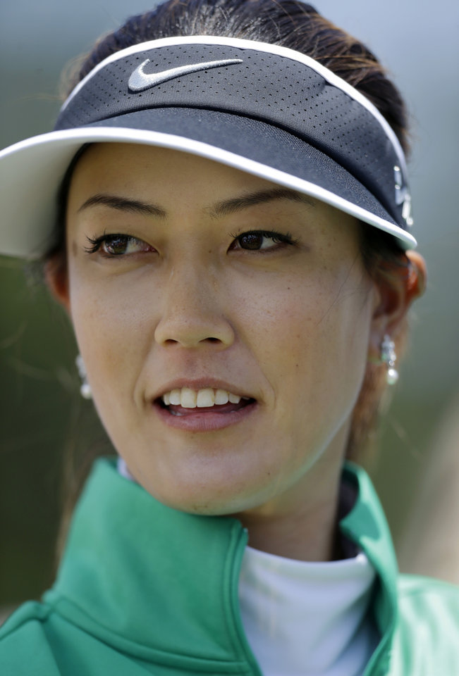 Photo - Michelle Wie waits to be interviewed after the first round of the ShopRite LPGA Classic golf tournament in Galloway Township, N.J., Friday, May 30, 2014. Wie finished 4 under par for the day. (AP Photo/Mel Evans)