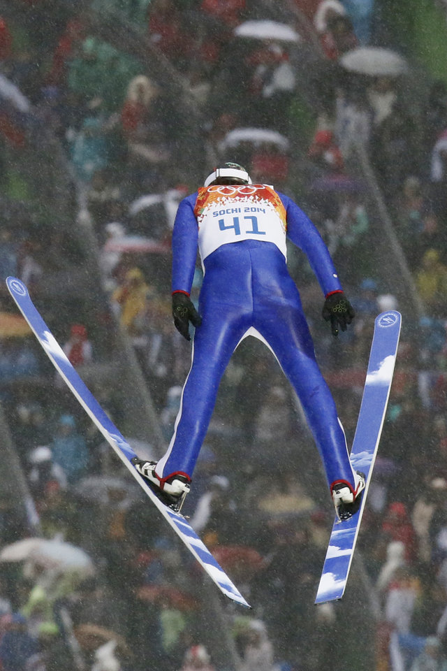 Photo - Norway's Magnus Hovdal Moan makes his jump during the Nordic combined individual Gundersen large hill competition at the 2014 Winter Olympics, Tuesday, Feb. 18, 2014, in Krasnaya Polyana, Russia. (AP Photo/Dmitry Lovetsky)