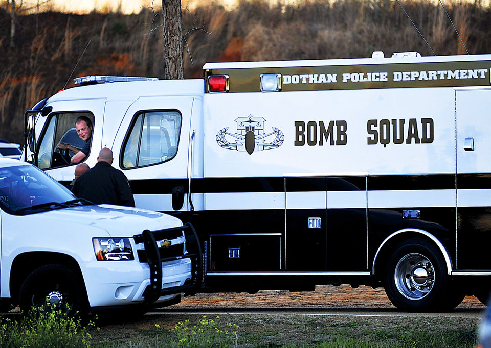 The Dothan Police Department Bomb Squad van rolls into a checkpoint in Pinckard, Ala., below the home where Tuesday's school bus shooting suspect is barricaded in a bunker with a five-year-old boy as a hostage Thursday, Jan. 31, 2013. Speaking into a 4-inch-wide ventilation pipe, hostage negotiators tried Thursday to talk a man into releasing a kindergartener and ending a standoff in an underground bunker that stretched into its third day. (AP Photo/The Dothan Eagle, Jay Hare)
