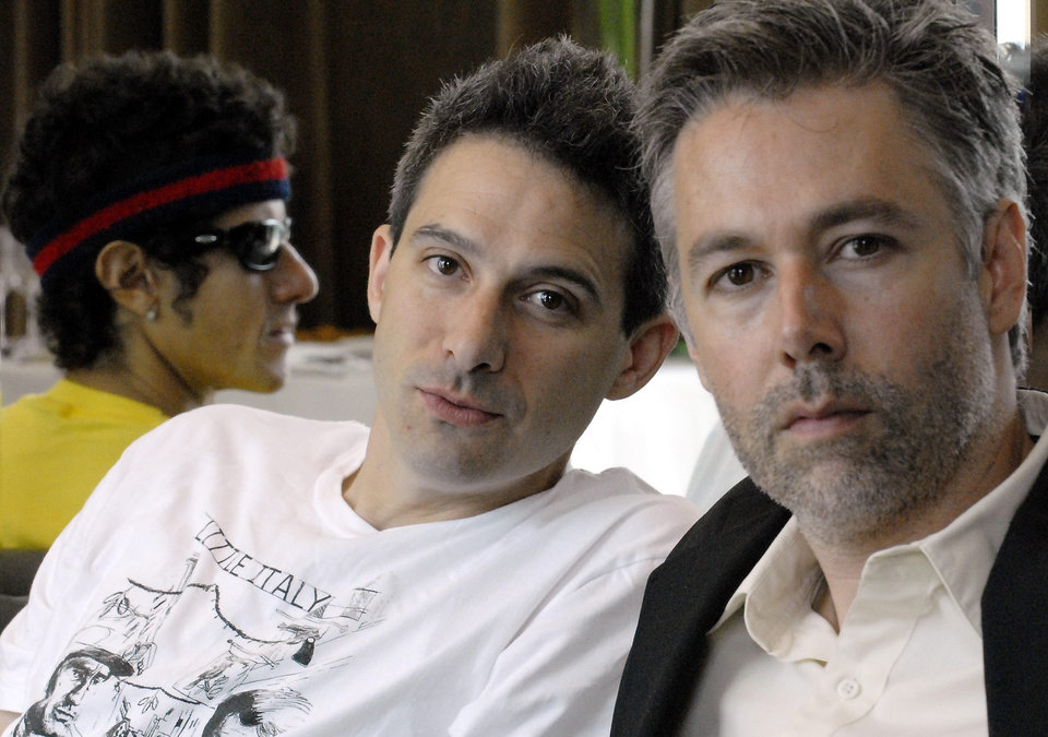 """FILE - In this July 26, 2006 file photo, Beastie Boys members Adam Yauch """"MCA,"""" right, Adam Horovitz """"Adrock,"""" center, and Mike Diamond """"Mike D,"""" reflected in a mirror, pose for a photograph during an interview in Toronto. Yauch, the gravelly voiced Beastie Boys rapper who co-founded the seminal hip-hop group, has died at age 47. The cause of death wasn't immediately known. Yauch, who's also known as MCA, was diagnosed with a cancerous parotid gland in 2009. (AP Photo/The Canadian Press, Aaron Harris)"""