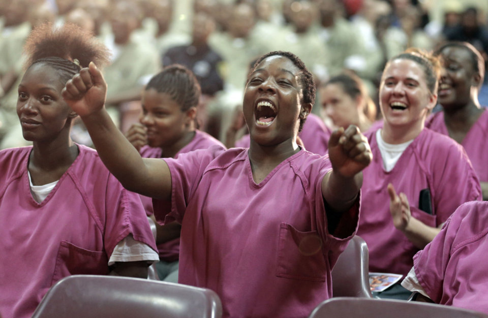 In this Aug. 27, 2013, photo, inmate Kristy Montgomery cheers from her seat while watching rappers perform a hip hop adaptation of William Shakespeare\'s Othello, titled