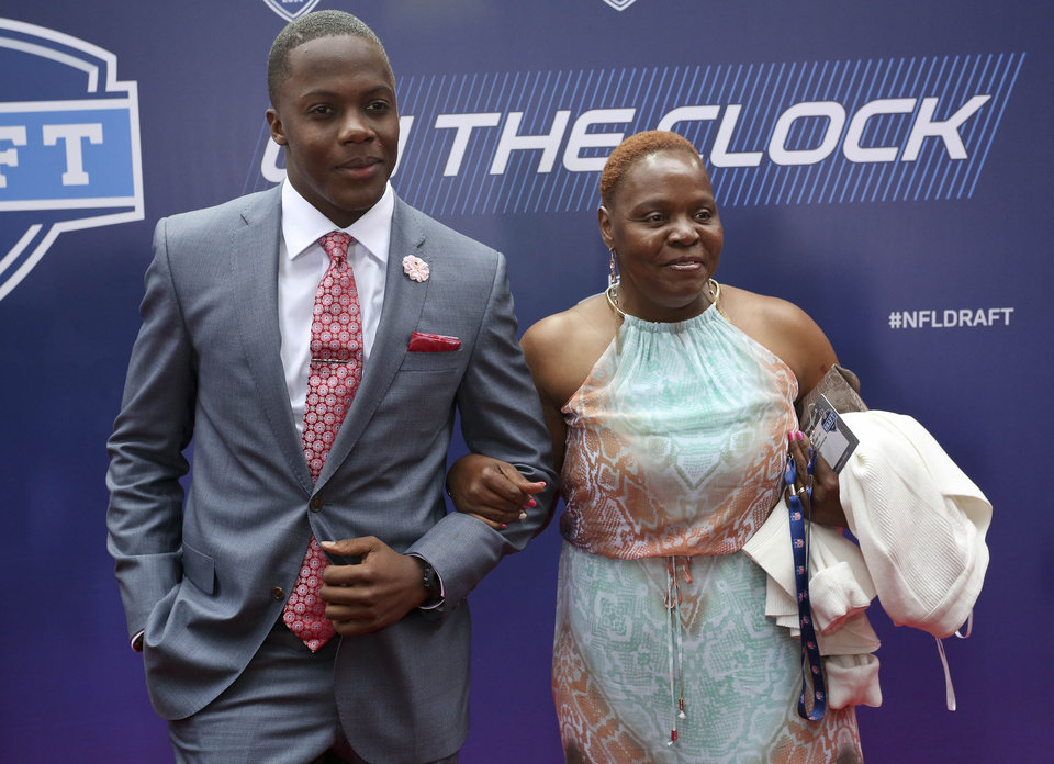 Photo - Louisville quarterback Teddy Bridgewater poses for photos with his mother, Rose Murphy, upon arriving for the first round of the 2014 NFL Draft, Thursday, May 8, 2014, in New York. (AP Photo/Craig Ruttle)