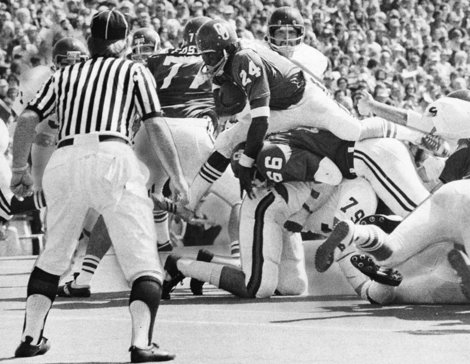"UNIVERSITY OF OKLAHOMA: ""High-hurdling Joe Washington comes over the line to pick up a first down for the Sooners"" against the Miami Hurricane as the Sooners downed Miami 24-20 in Norman. Staff photo by Bob Albright taken 10/6/73; photo ran in the 10/7/73 Daily Oklahoman. File:  College Football/OU/OU-Miami/Joe Washington/1973"