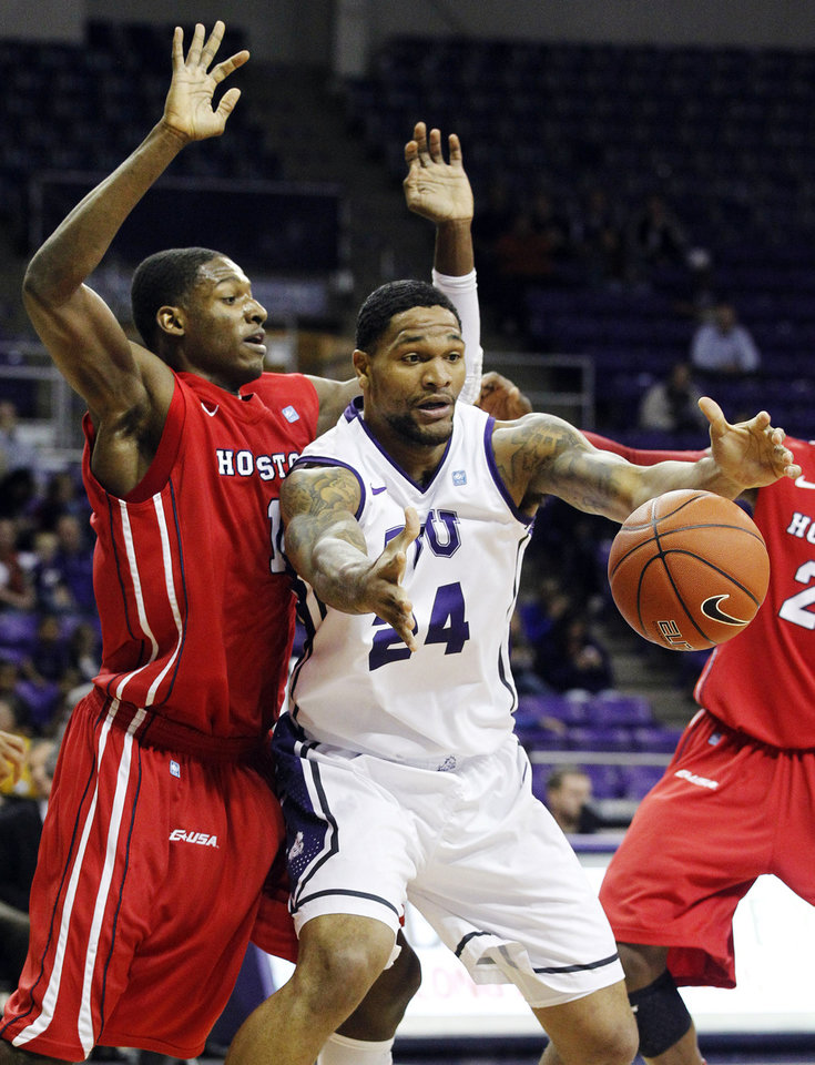 TCU's Adrick Mckinney (24) takes a pass in front of Houston's Mikhail McLean during their NCAA college basketball game, Tuesday, Dec. 4, 2012, in Fort Worth, Texas. Houston won 54-48. (AP Photo/The Fort Worth Star-Telegram, Ron T. Ennis)  MAGS OUT; (FORT WORTH WEEKLY, 360 WEST); INTERNET OUT