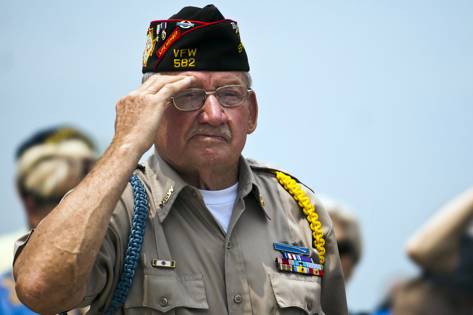 Photo -   Don Kengerski salutes as members of the Marine Corps League Flint Detachment #155 present the colors during the 7th annual Memorial Day ceremony at the Great Lakes National Cemetery in Holly, Mich., on Sunday May 27, 2012. (AP Photo/The Flint Journal, Lathan Goumas)