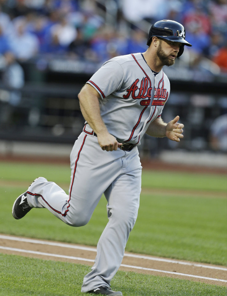 Photo - Atlanta Braves' Evan Gattis runs the bases after hitting a home run during the second inning of a baseball game against the New York Mets, Wednesday, July 24, 2013, in New York. (AP Photo/Frank Franklin II)