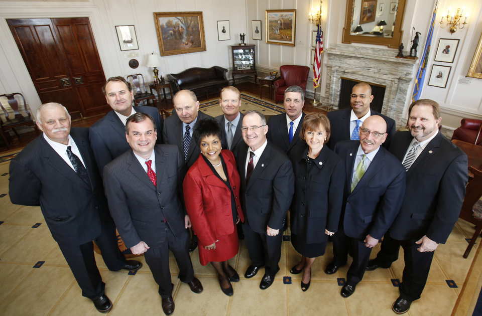 These are the Democrats in the state Senate for 2013. Front row left to right: Sen. Minority Leader Sean Burrage and Senators Constance Johnson, Roger Ballenger, Susan Paddack, Al McAffrey and Randy Bass. Back row left to right: Senators Earl Garrison, John Sparks, Jerry Ellis, Tom Ivester, Charles Wyrick and Jabar Shumate. Photo By Steve Gooch, The Oklahoman