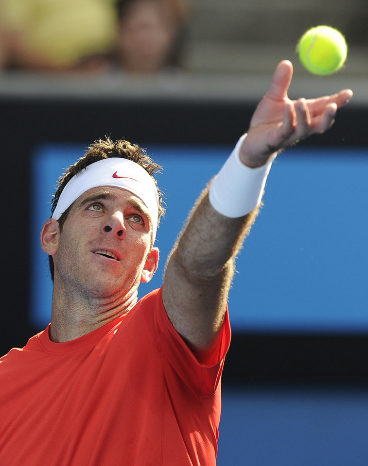 Photo - Juan Martin del Potro of Argentina serves to Rhyne Williams of the U.S. during their first round match at the Australian Open tennis championship in Melbourne, Australia, Tuesday, Jan. 14, 2014. (AP Photo/Andrew Brownbill)