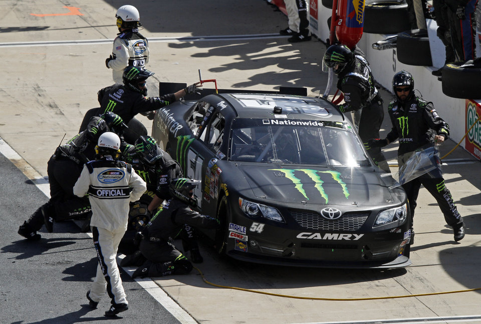 Photo - Kyle Busch makes a pit stop during the NASCAR Nationwide Series auto race at Bristol Motor Speedway on Saturday, March 15, 2014, in Bristol, Tenn. Busch won the race. (AP Photo/Wade Payne)