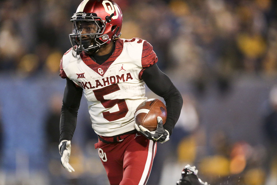 Photo - Oklahoma Sooners wide receiver Marquise Brown (5) runs towards the end zone during the NCAA football game between the Oklahoma Sooners and the West Virginia Mountaineers at Mountaineer Field at Milan Puskar Stadium in Morgantown, W.Va on Friday, November 23, 2018. IAN MAULE/Tulsa World