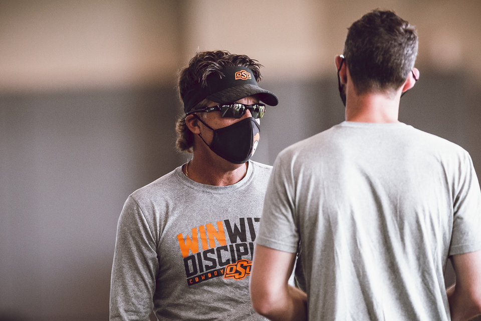 Photo - Mike Gundy is excited about his team's energy and discipline in preseason camp. [Bruce Waterfield/Courtesy of OSU Athletics]