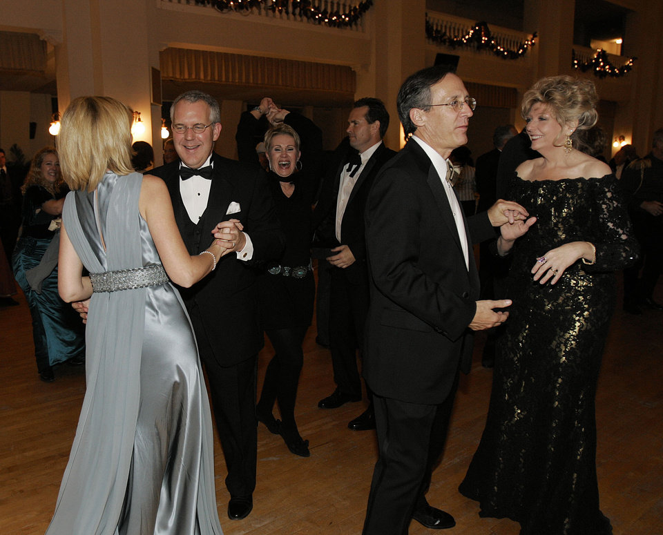 Photo - Oklahoma Gov. Brad Henry dances with his wife, Kim, left, along with Centennial Ball Chairman Jim Dewhurst and his wife, Theresa, right, at the Oklahoma Centennial Statehood Inaugural Ball, Saturday, Nov. 17, 2007, at the Guthrie Scottish Rite Masonic Center, in Guthrie, Okla. By Bill Waugh, The Oklahoman