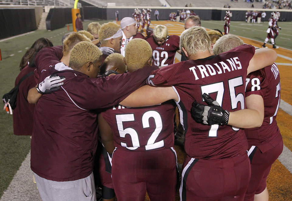 Members of the Jenks team huddle up during the Class 6A Oklahoma state championship football game between Norman North High School and Jenks High School at Boone Pickens Stadium on Friday, Nov. 30, 2012, in Stillwater, Okla.   Photo by Chris Landsberger, The Oklahoman