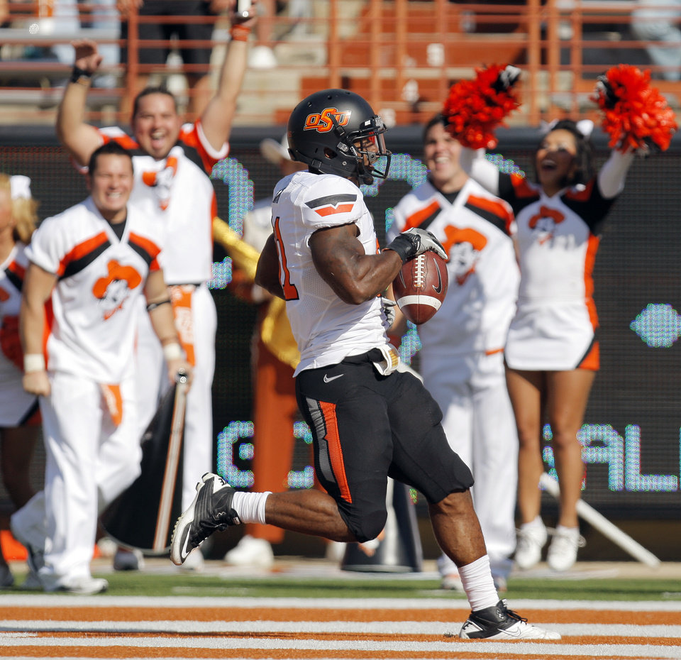 Photo - Cheerleaders react as Oklahoma State's Jeremy Smith (31) rushes for a touchdown in the second quarter during a college football game between the Oklahoma State University Cowboys (OSU) and the University of Texas Longhorns (UT) at Darrell K Royal-Texas Memorial Stadium in Austin, Texas, Saturday, Oct. 15, 2011. Photo by Nate Billings, The Oklahoman