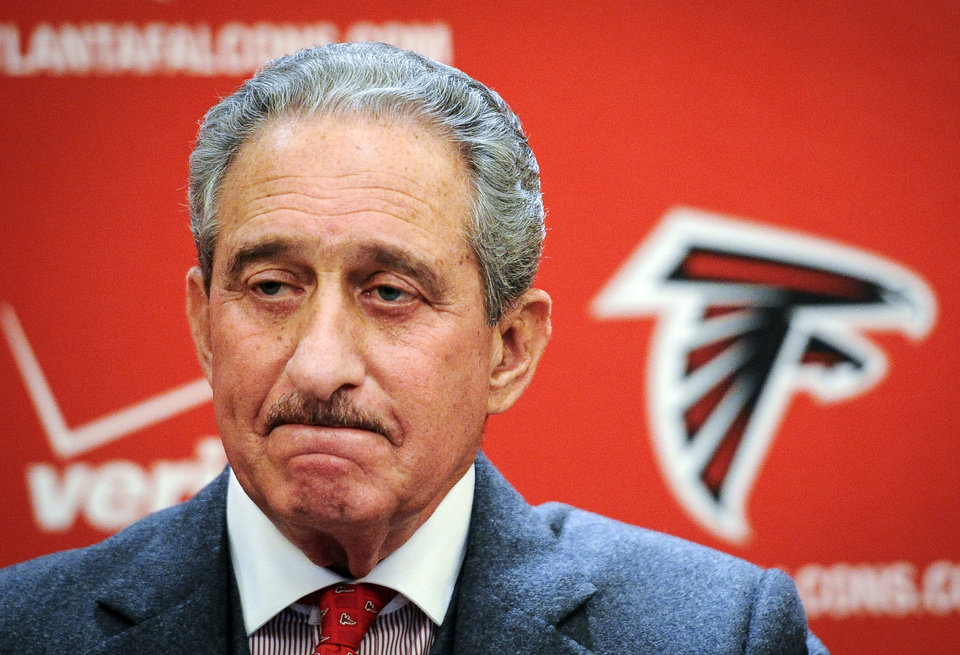 Photo - Atlanta Falcons owner Arthur Blank addresses the media during an end of season news conference on Monday, Jan. 6, 2014, in Atlanta. The Falcons finished the 2013 season 4-12. (AP Photo/John Amis)