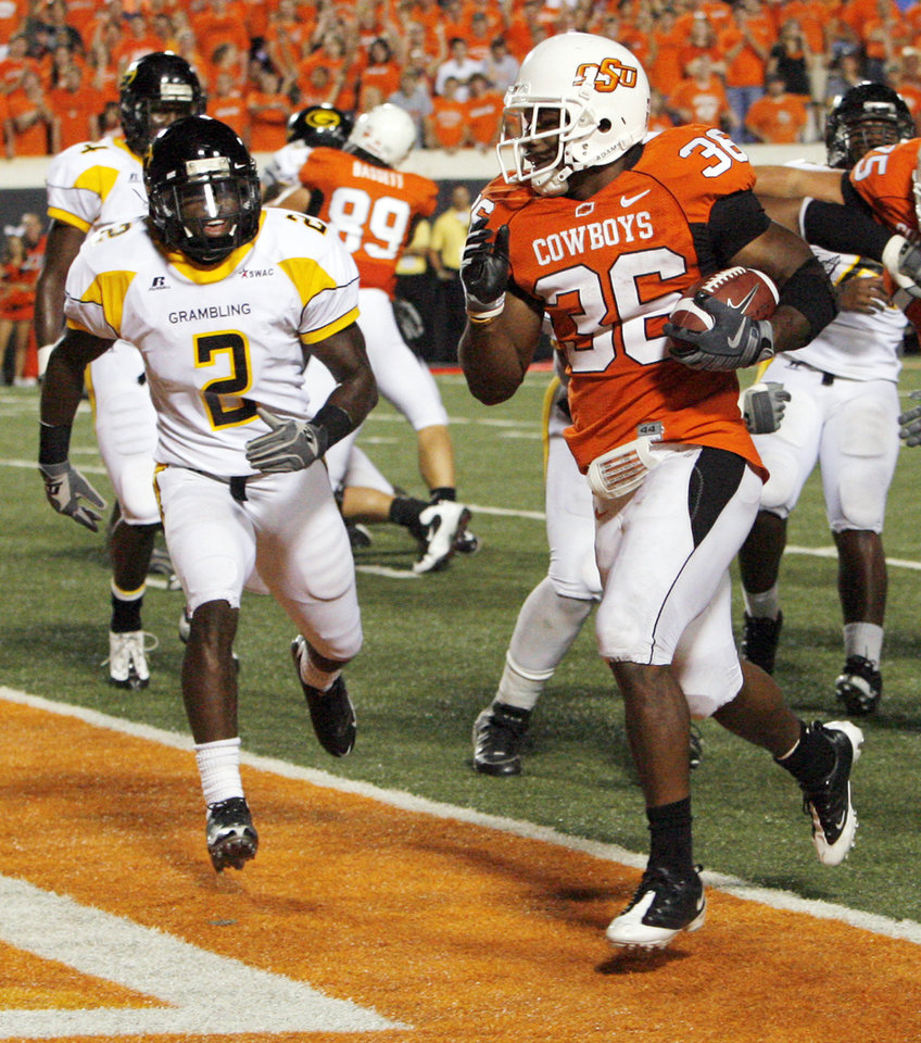 Photo - OSU's Jeremy Smith (36) rushes for a touchdown in the fourth quarter past Grambling's Lance Castleberry (2) in the fourth quarter of the college football game between the Oklahoma State University Cowboys (OSU) and the Grambling State University Tigers (GSU) at Boone Pickens Stadium in Stillwater, Okla., Saturday, September 26, 2009. OSU won, 56-6. Photo by Nate Billings, The Oklahoman ORG XMIT: KOD