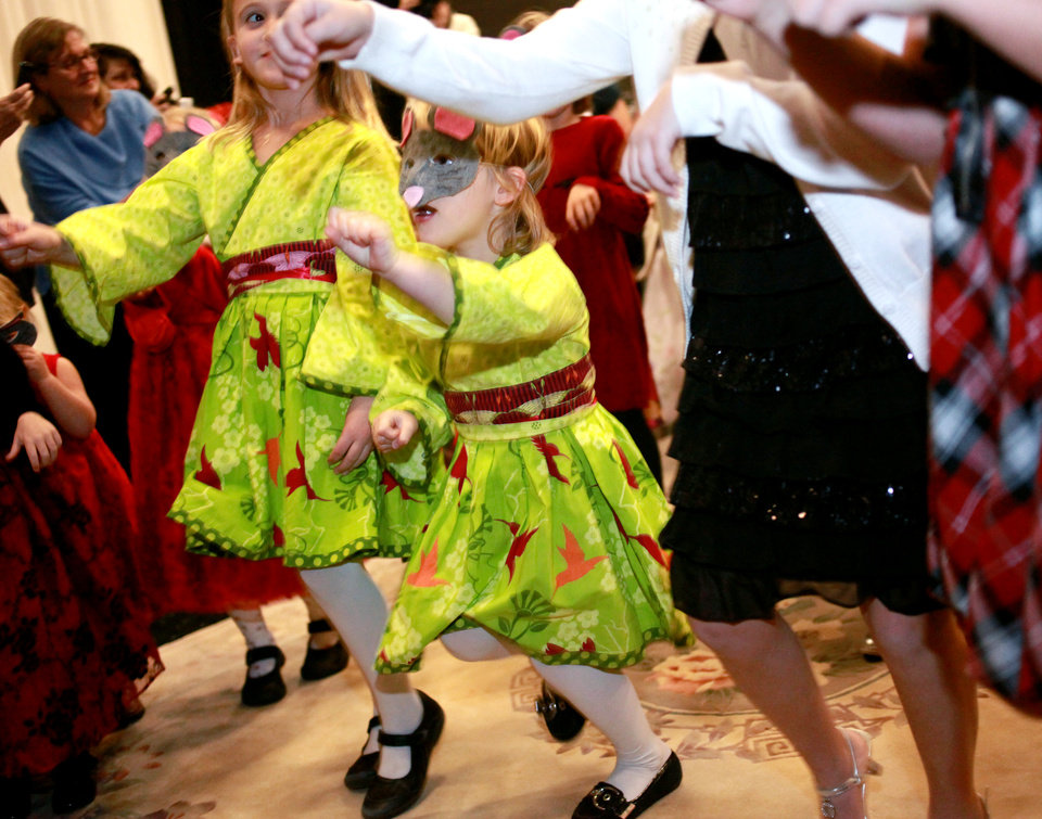 Sophie Scaramucci (center) 4, and her sister Stella (left) learn to box from the Mouse King during the Sand Plum Fairy Tea Party at The Nancy O'Brian Center for the Performing Arts at Norman North High School in Norman, Oklahoma on Sunday, Nov. 28, 2010. Photo by John Clanton, The Oklahoman