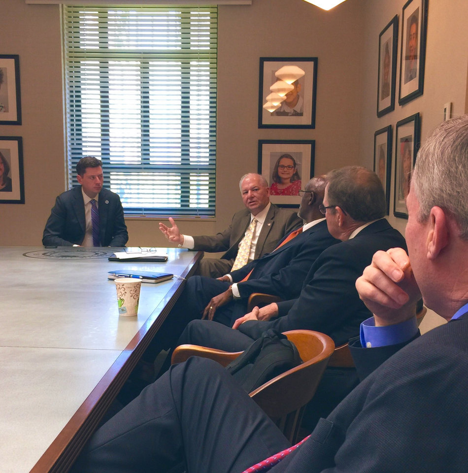 Photo -  Mayor David Holt meets with law enforcement officials about streetlight repairs earlier this week. [Twitter image]