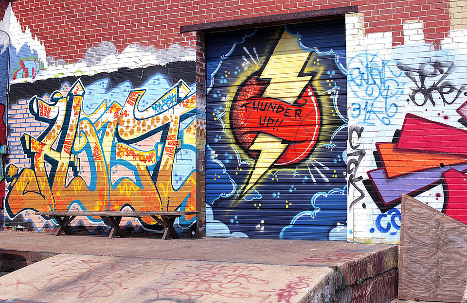 Left: Thunder graffiti decorates an alley at NW 10 Street and Broadway in Oklahoma City. Photo by Garett Fisbeck, The Oklahoman