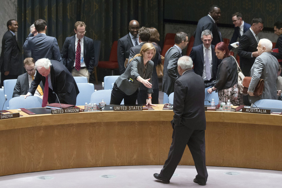 Photo - United States U.N. Ambassador Samantha Power, center, reaches out to shake hands with Palestinian U.N. Ambassador Riyad Mansour, center right, following a meeting of the U.N. Security Council on the worsening situation in Gaza at United Nations headquarters, Monday, July 28, 2014. The U.N. Security Council called for
