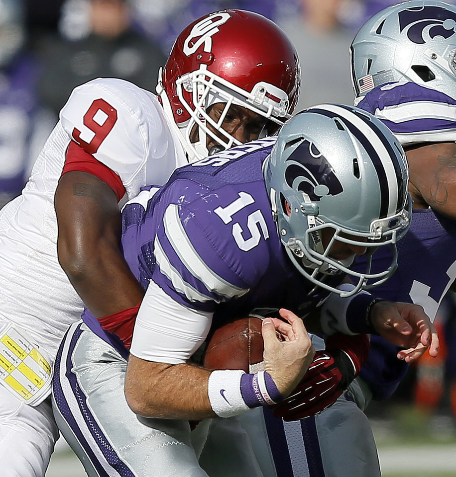 Oklahoma's Gabe Lynn (9) brings down Kansas State 's Jake Waters (15) during an NCAA college football game between the Oklahoma Sooners and the Kansas State University Wildcats at Bill Snyder Family Stadium in Manhattan, Kan., Saturday, Nov. 23, 2013. Oklahoma won 41-31. Photo by Bryan Terry, The Oklahoman