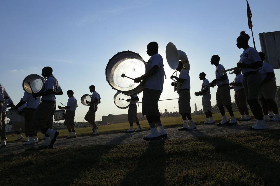Photo - The Star Spencer band makes it's way into the stadium and around the field during the high school football game between Millwood and Star Spencer in Spencer, Thursday, September 5, 2013. Photo by Doug Hoke, The Oklahoman