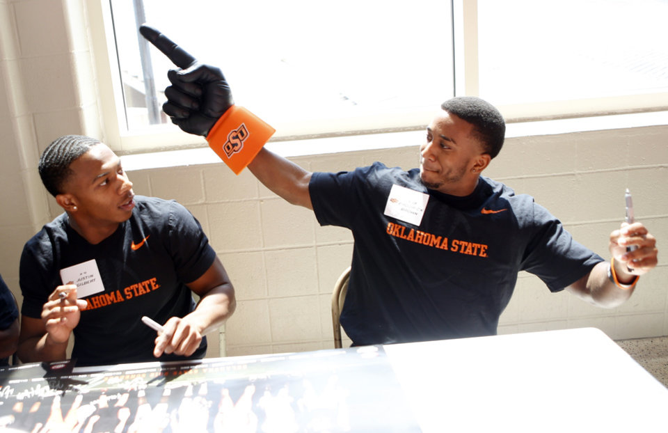 Photo - Oklahoma State football players Brodrick Brown, right,  and Justin Gilbert joke around during Oklahoma State's Fan Appreciation Day at Gallagher-Iba Arena in Stillwater, Okla., Saturday, Aug. 4, 2012. Photo by Sarah Phipps, The Oklahoman