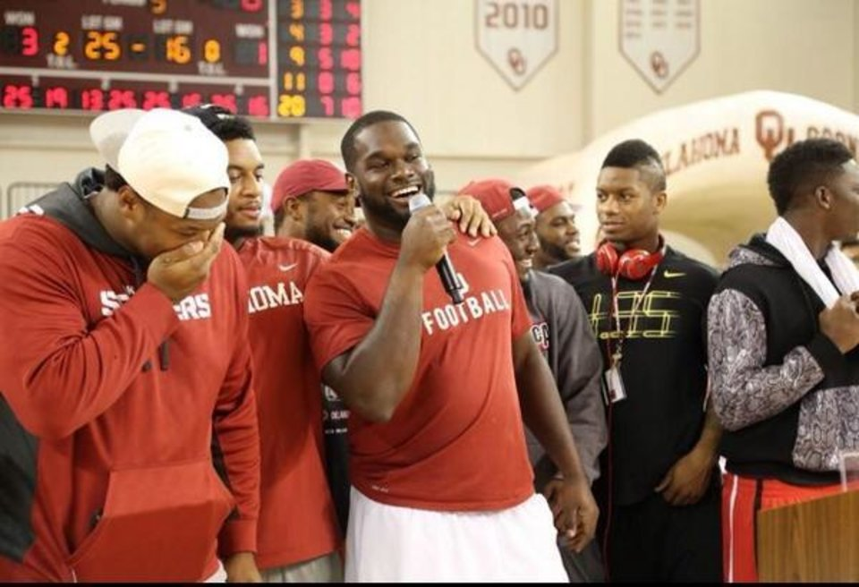 Photo -  Suspended OU running back Joe Mixon, left, was with the football team during Thursday night's team pep rally. PHOTO COURTESY OU ATHLETICS