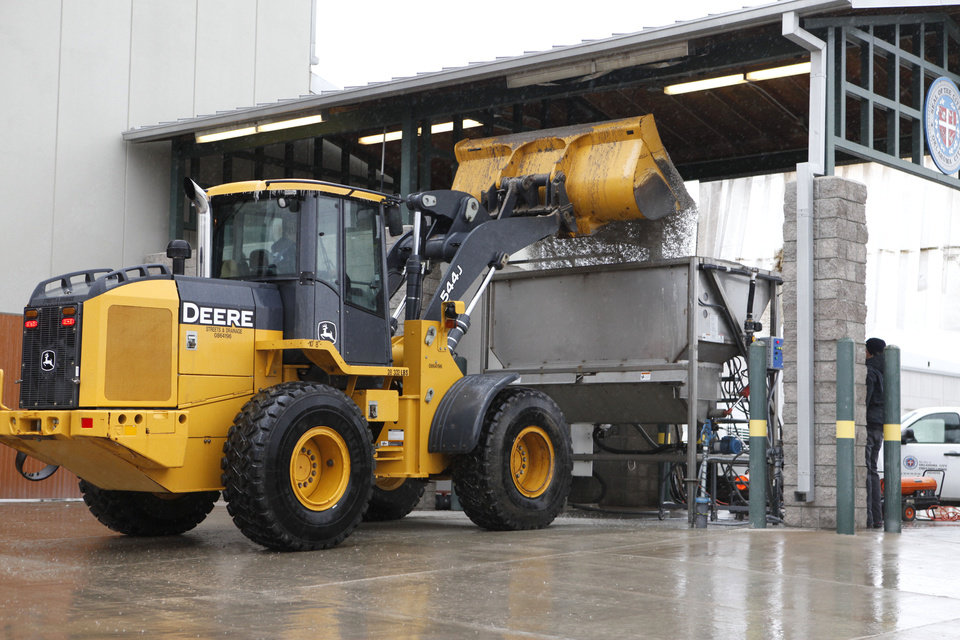 A front end loader dumps salt into a brine mixer at the OKC maintenance facility in SW Oklahoma City, OK, Thursday, Jan. 28, 2010. By Paul Hellstern, The Oklahoman
