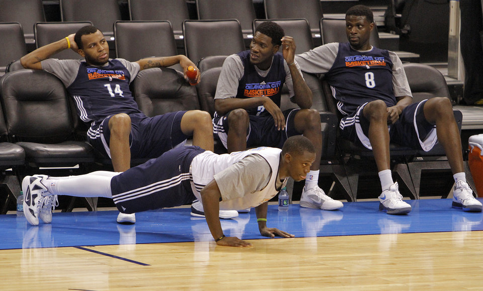 Photo - Reggie Jackson does pushups in front of Daequan Cook, Royal Ivey and Nazr Mohammed during the NBA Finals practice day at the Chesapeake Energy Arena on Monday, June 11, 2012, in Oklahoma City, Okla. Photo by Chris Landsberger, The Oklahoman