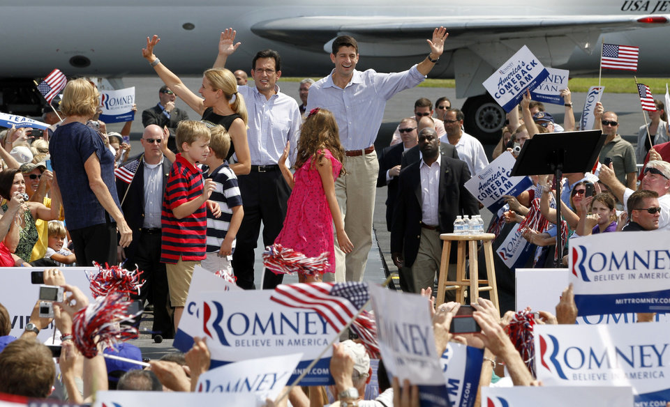 Photo -   Republican vice presidential candidate Rep. Paul Ryan, R-Wis., right and House Majority Leader Eric Cantor of Va., left, wave to the crowd as they arrive for a rally at the airport in Richmond, Va., Friday, Aug. 31, 2012. ( AP Photo/Steve Helber)