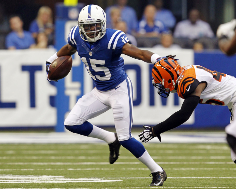 Photo -   Indianapolis Colts wide receiver LaVon Brazill (15) holds off a tackle from Cincinnati Bengals defensive back Jeromy Miles in the first half of an NFL preseason football game in Indianapolis, Thursday, Aug. 30, 2012. (AP Photo/John Sommers II)