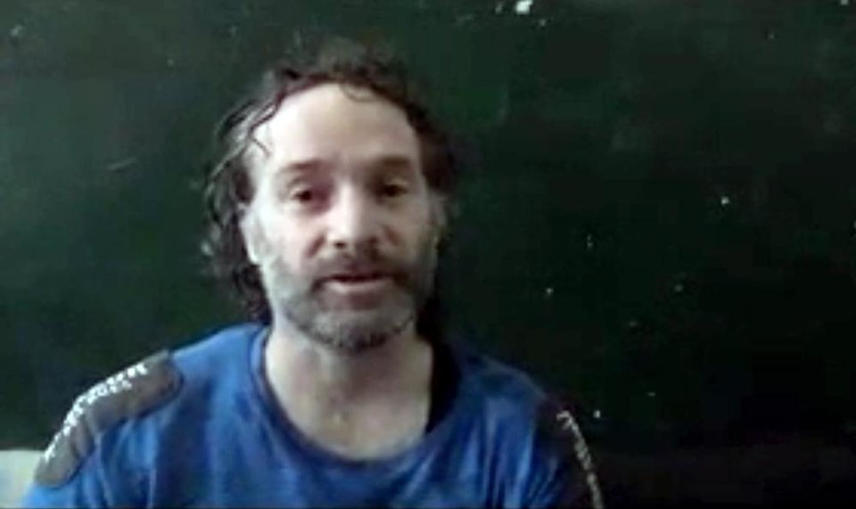 Photo - In this image made from undated video obtained by The Associated Press, which has been authenticated based on its contents and other AP reporting, a man believed to be Peter Theo Curtis, a U.S. citizen held hostage by an al-Qaida linked group in Syria, delivers a statement. The U.S. government said on Sunday, Aug. 24, 2014 that Curtis, who had been held hostage for about two years, had been released. (AP Photo)