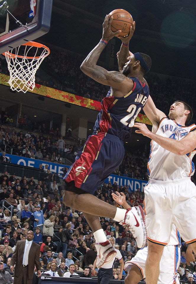 Photo - Cleveland's LeBron James  shoots over Oklahoma City's Nick Collison (4) during the NBA game between the Oklahoma City Thunder and Cleveland Cavaliers, Sunday, Dec. 21, 2008, at the Ford Center in Oklahoma City. PHOTO BY SARAH PHIPPS, THE OKLAHOMAN