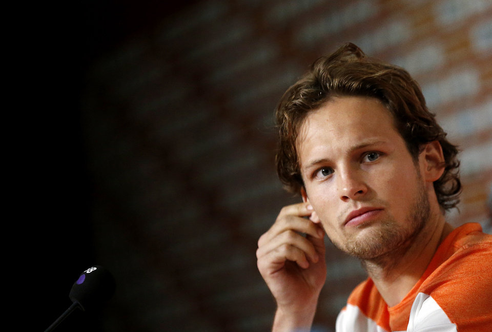 Photo - Daley Blind of the Netherlands listens to his team mate speak during a press conference after a training session in Rio de Janeiro, Brazil, Sunday, June 15, 2014. His commanding play in that match has sparked intense speculation in England that he could be playing in the red of Manchester United next season when current Netherlands coach Louis van Gaal moves to Old Trafford and attempts to rebuild the storied club after a disastrous season. (AP Photo/Wong Maye-E)