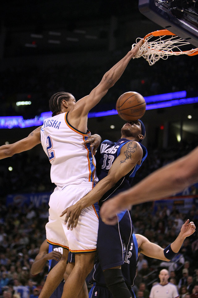 Oklahoma City Thunder forward Thabo Sefolosha dunks over Dallas forward James Singleton during the Thunder - Mavericks game March 2, 2009 in the Ford Center in Oklahoma City.    BY HUGH SCOTT, THE OKLAHOMAN